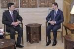 El presidente de Siria, Bashar al-Assad y el vicecanciller chino, Zhai Jun.