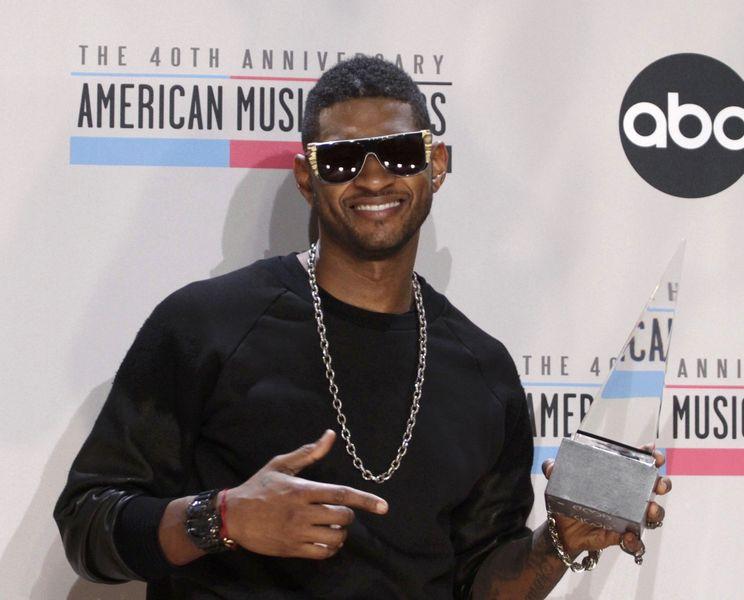 Usher, estrella del R&B laureado con varios premios Grammy.